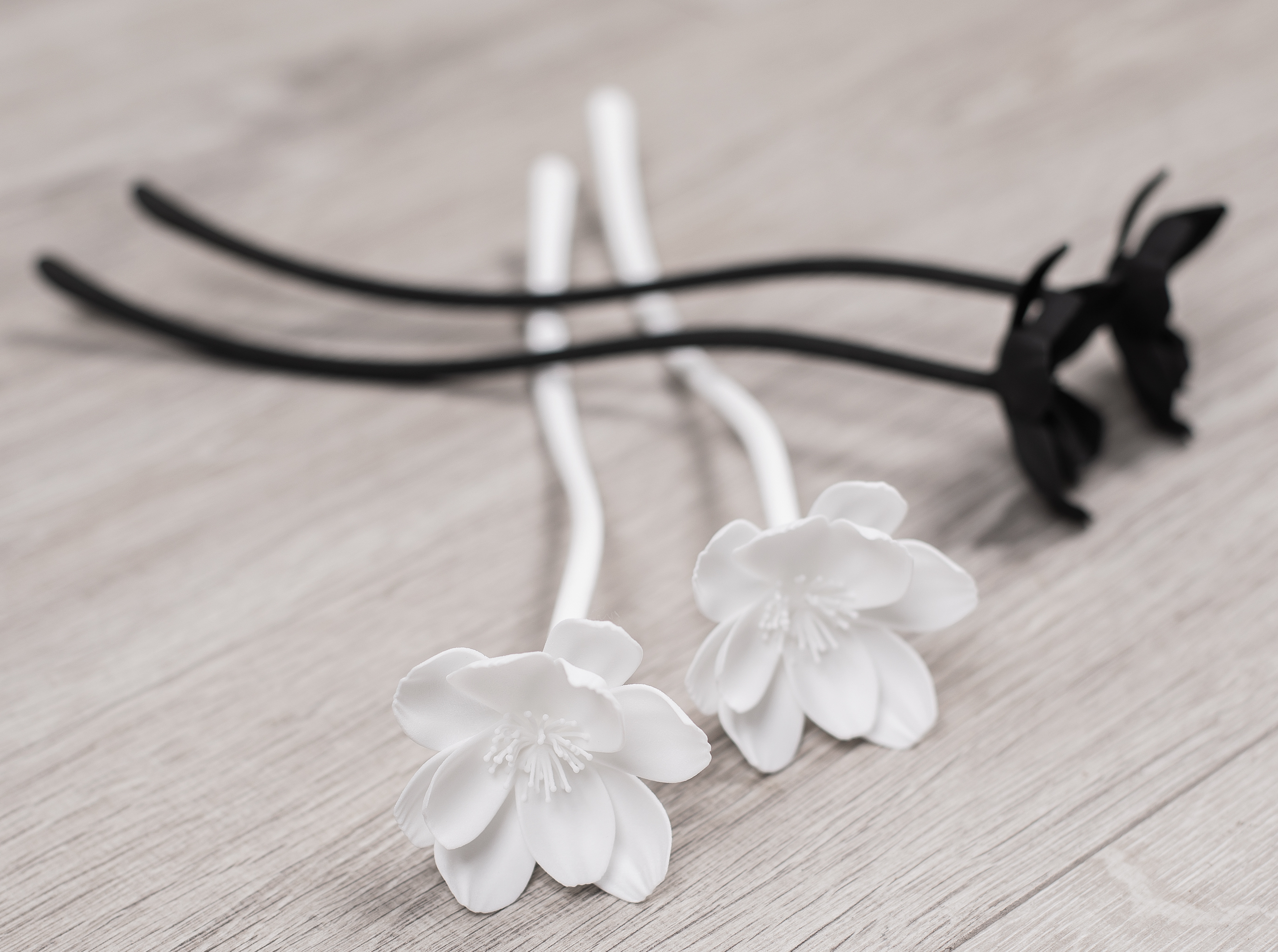 emotive by Sarah Nazim. The Bloom Collection. Elegant and modern black and white artificial flowers that resemble matte porcelain.